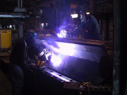 Programmed welding SAW and FCAW as well as manual SMAW, FCAW, and GTAW are performed at Trans Bay Steel.